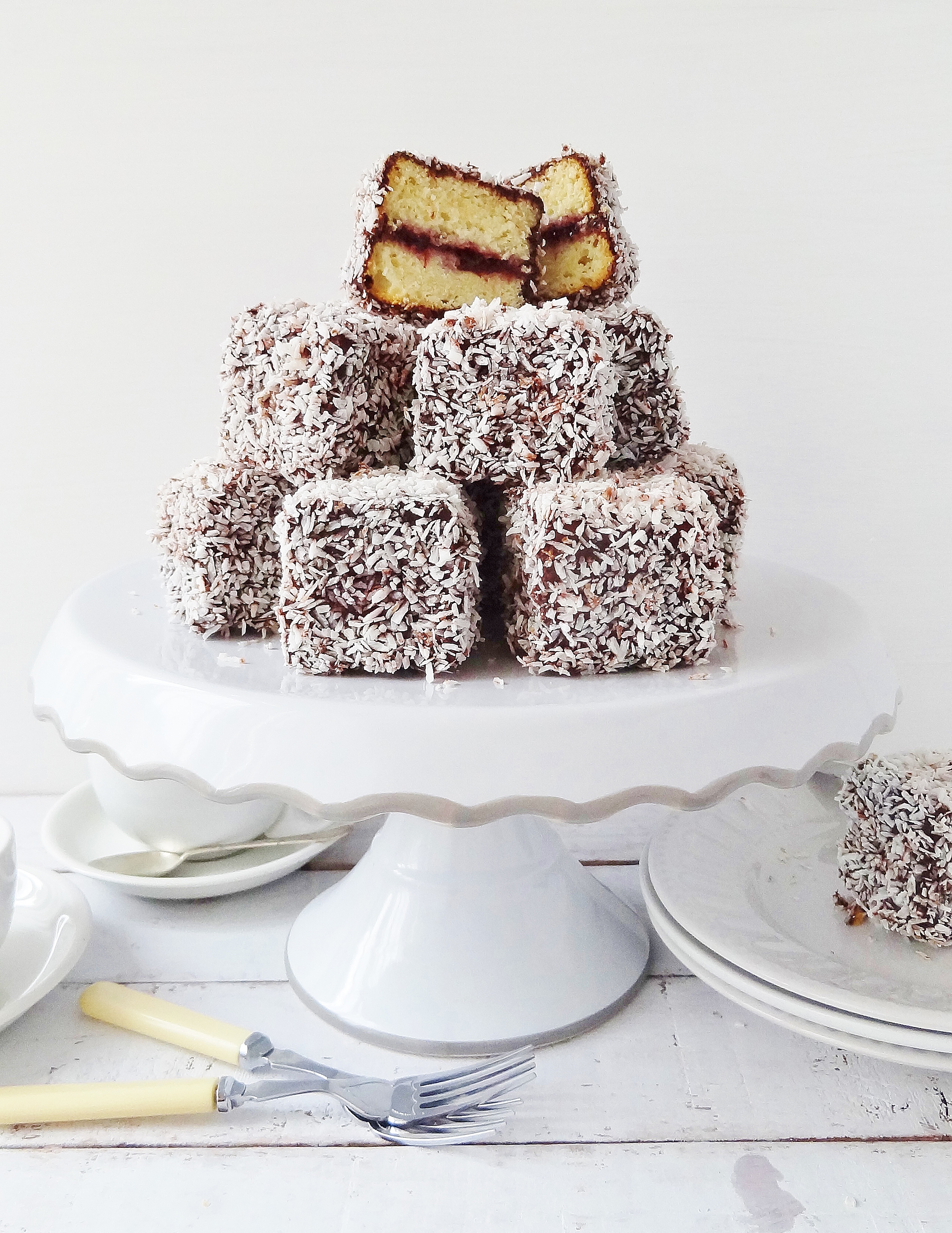 Jam-lamingtons-squares-of-vanilla-sponge-cake-filled-with-cherry-jam-coated-in-chocolate-and-coconut-Domestic-Gothess